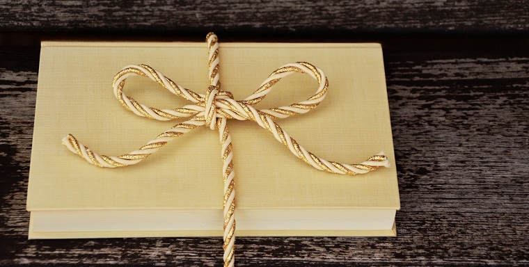 book wrapped in a ribbon
