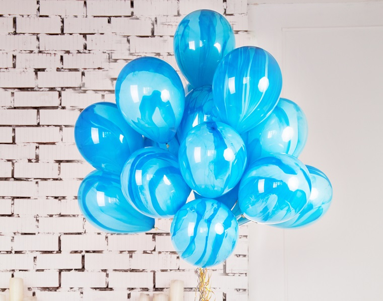 """Blue balloons with gold strings"