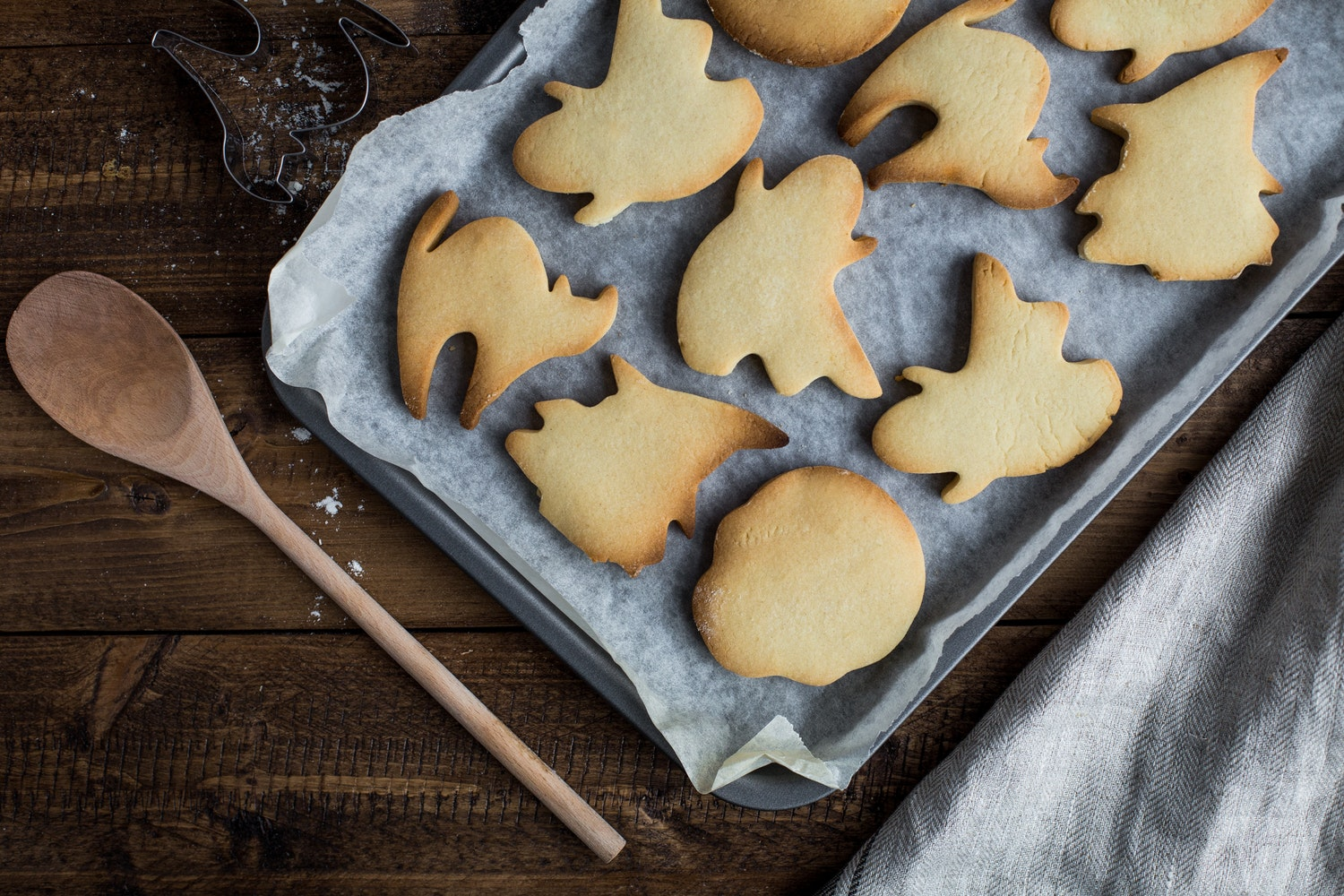sugar cookies cut into different halloween shapes