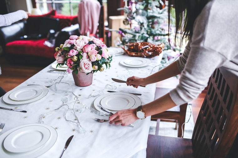 Woman setting up beautiful dinner set