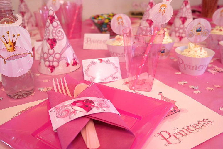 table setting of princess party decorations pink