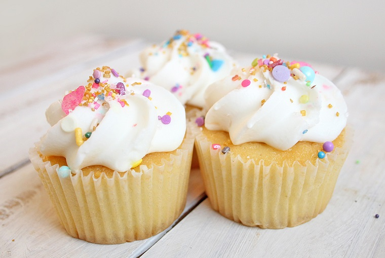 vanilla cupcakes with colorful sprinkles