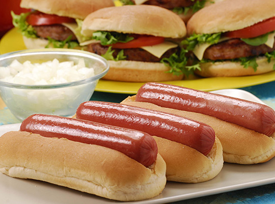 Party hot dogs and hamburgers on trays