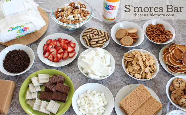 S'mores bar with marshmallow, strawberries, crackers and chocolate