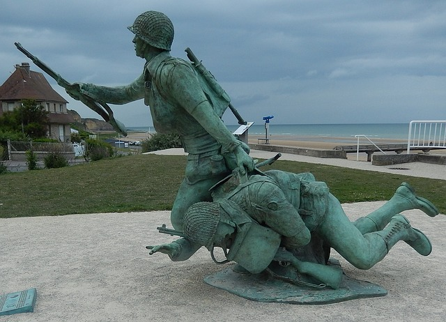 memorial day statue of soldier carrying another in war