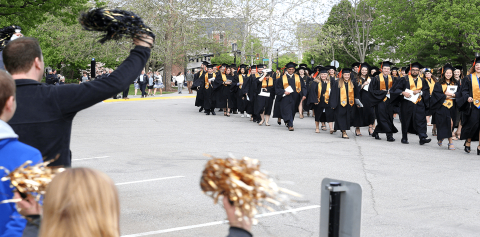 Students walking in a graduation procession