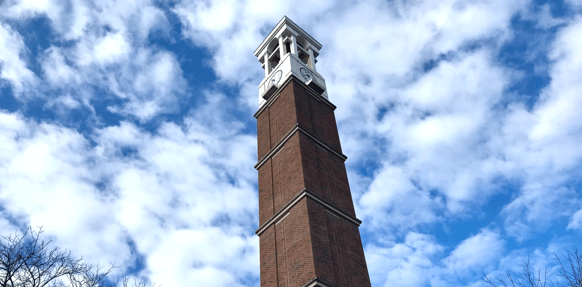 Purdue Bell Tower against a cloudy sky