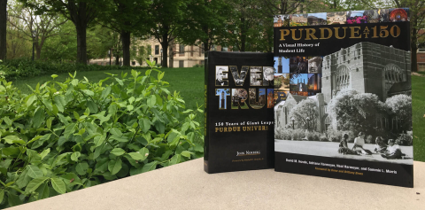 Books written about the history of Purdue displayed on campus