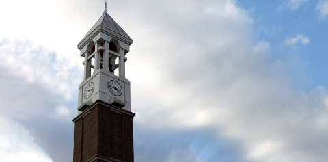 The Purdue Bell Tower against a blue sky