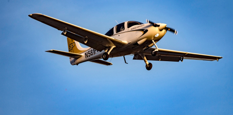 A Purdue plane flying through a cloudless sky