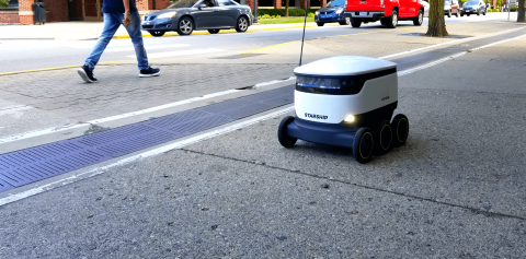 One of the new Starship Technologies delivery robots, driving along Grant St. near PMU.