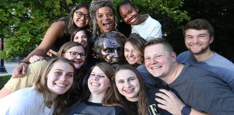 A group of Purdue agriculture students pose with the John Purdue statue