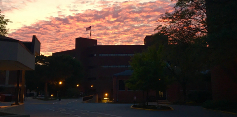 A pink sunset over the Knoy building