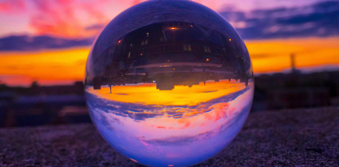 A glass orb reflecting a sunrise