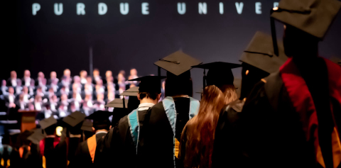 Students stand in line at a Purdue graduation ceremony