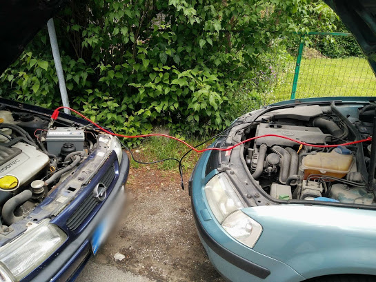 How to jump start a car with cables?