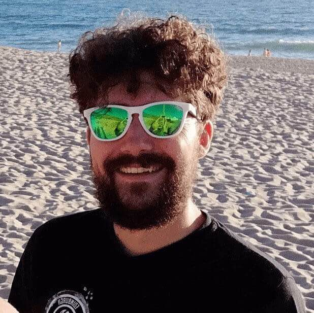 ReactJS Academy coach Richard Moss, looking pretty happy with a beach in the background