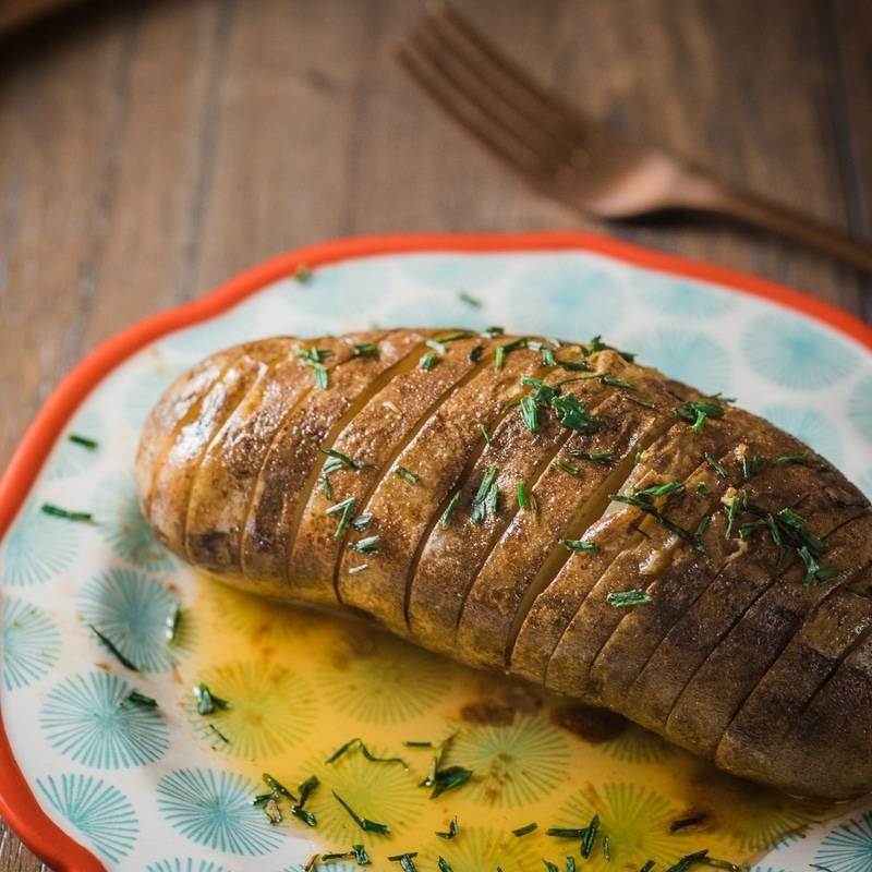 Slow Cooker Hasselback Potatoes with Honey-Sriracha Butter