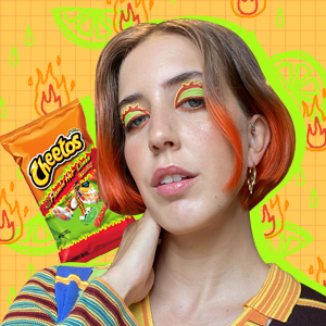 Woman with colorful hair and colorful Cheetoh's inspired makeup