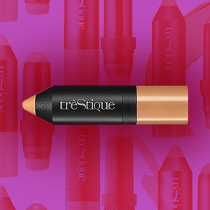 tréStiQue Face Stick on a pink background