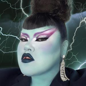 Makeup artist ArtistryBri in a Frankenstein's monster Halloween makeup look