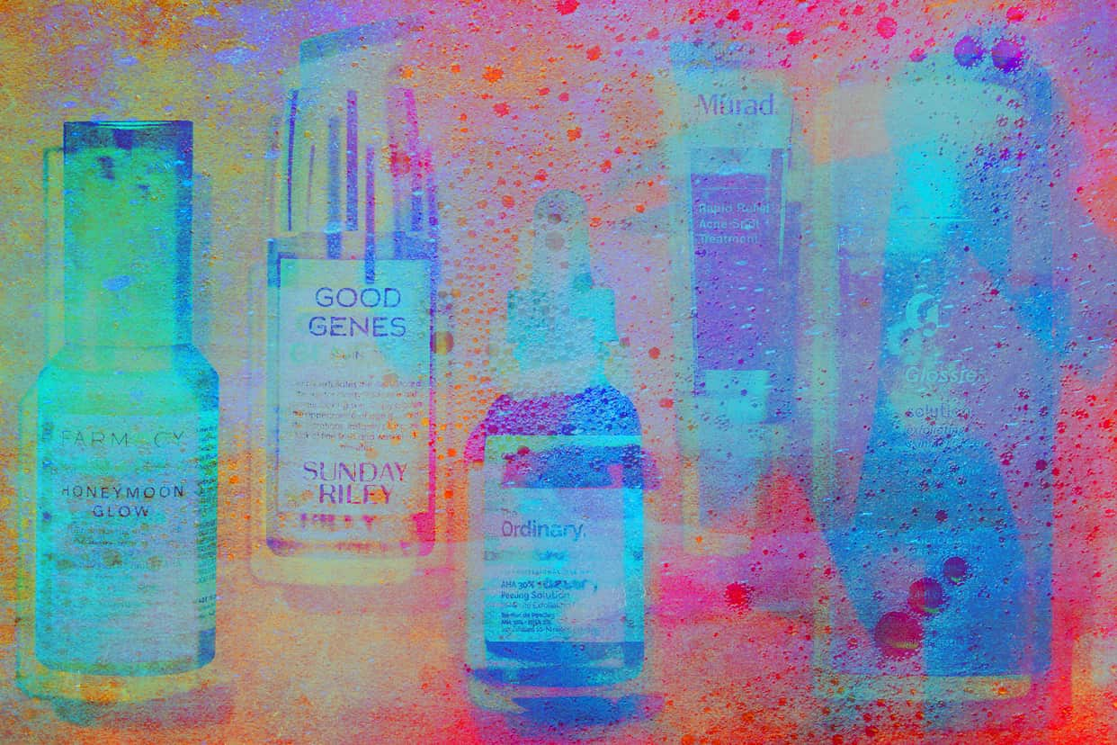 Different brands of products that contain acidic formulations on an iridescent and sudsy background