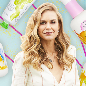HoliFrog founder Emily Parr surrounded by her brand's facial cleansers on a blue background