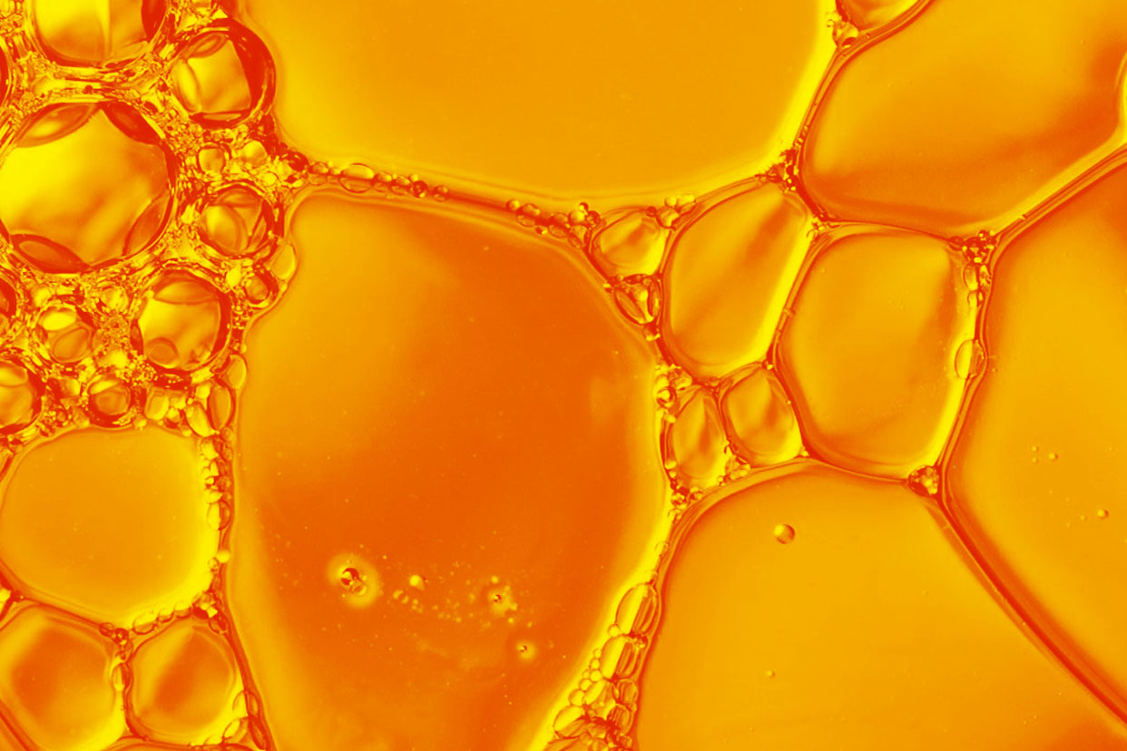 Orange bubbly oil