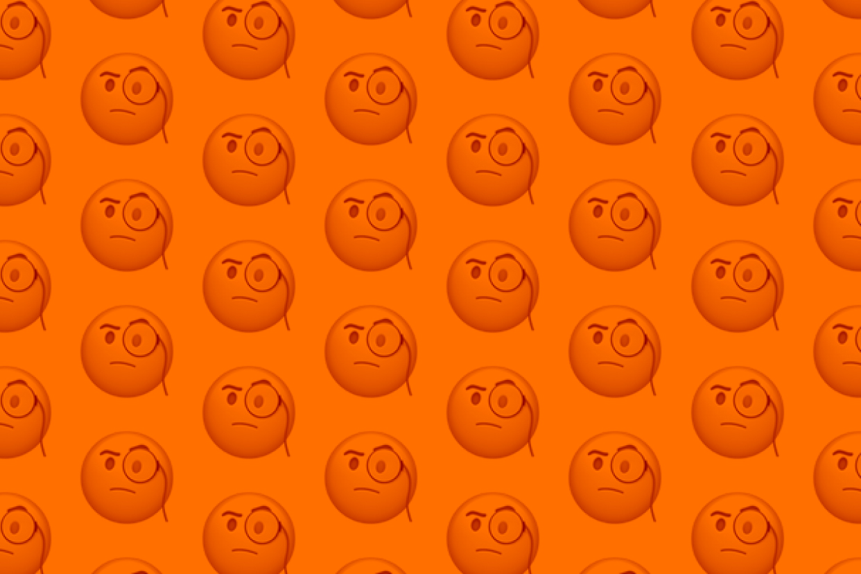 Face with monocle emoji on an orange background