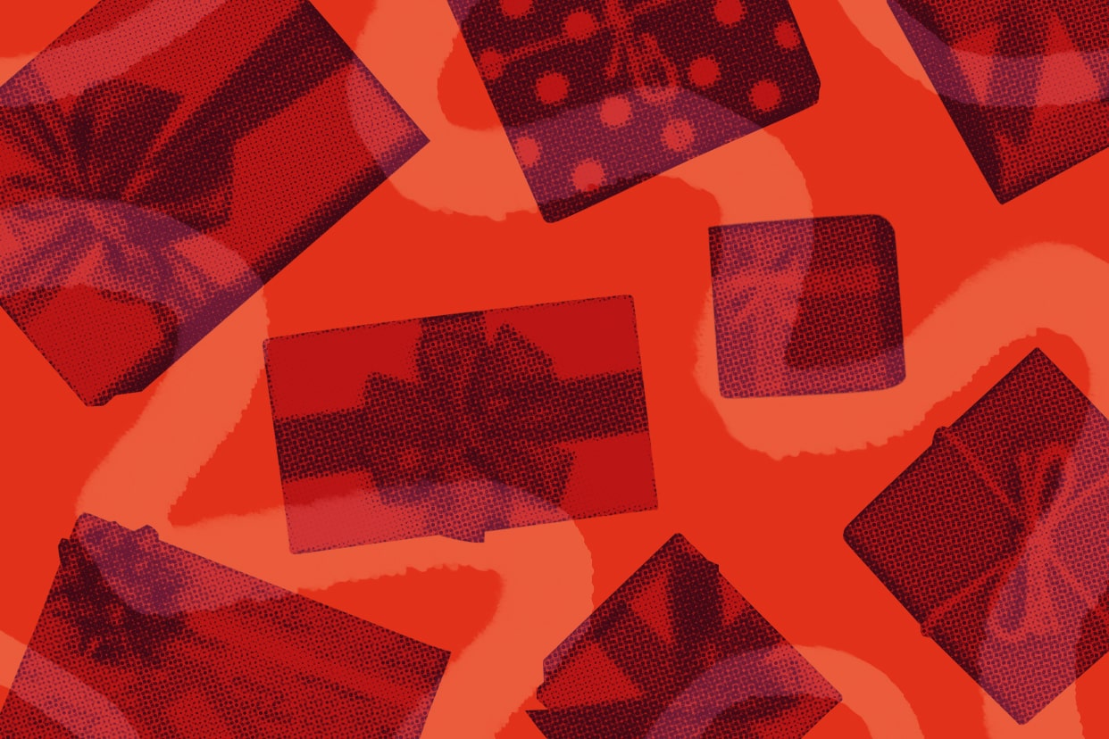 Wrapped holiday presents scattered on a red background