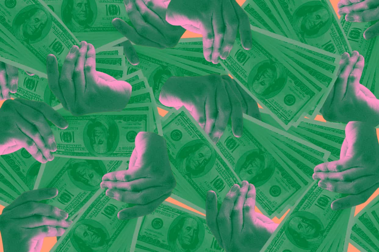 Several hands fanning out one hundred dollar bills