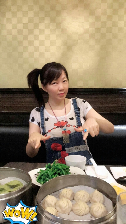 Enjoying the Din Tai Fung dumplings after a busy day.