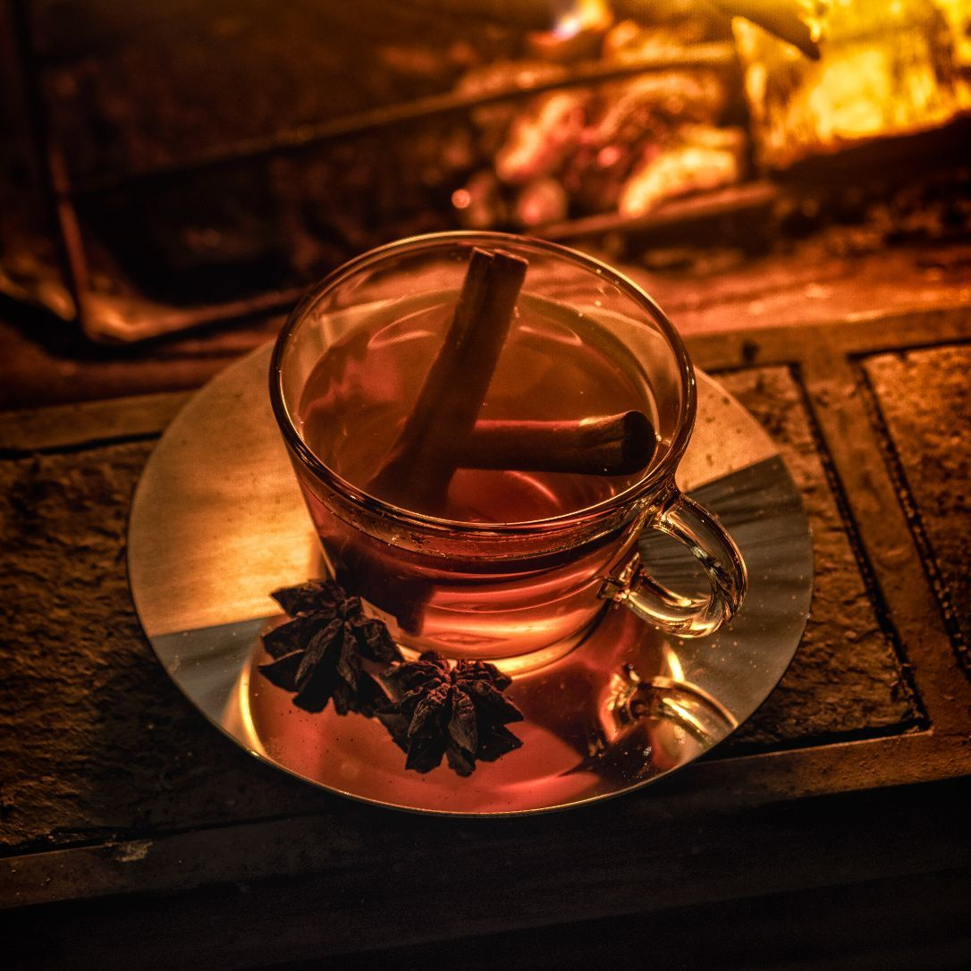 """In The Bartender's Standard Manual (Powell, 1979) the Hot Toddy is listed simply as 1 ½ jigger of """"Liquor"""" mixed with boiling water, and a bit of sugar and lemon. It has long been prescribed for its medicinal effects however dubious those may be. Early recipes often call for brandy while whiskey is more often the spirit of choice today. For a dinner party last winter, I wanted to serve a vacuum pot (coffee siphon) based cocktail. There is something magical about the coffee siphon. The slow steeping and counterintuitive physics of the coffee siphon makes for an entertaining and communal preparation that invokes the spirit of ancient alchemists. They are the perfect tool for crafting a warming Hot Toddy to share with friends. For Ben's Hot Toddy, I first experimented with wine, gin, vodka, and rum, but ultimately selected bourbon as the base spirit. There are over a dozen ingredients in this preparation, but all are easy to obtain. I like to use a vanilla flavored tea to compliment the winter spice mix, but any aromatic blend will do."""