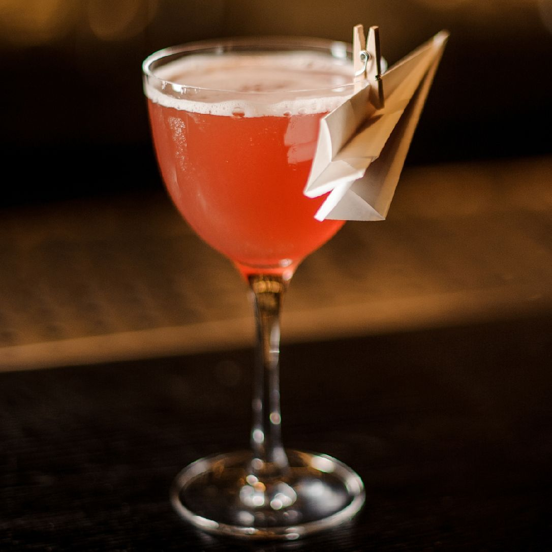 The Paper Plane is a relatively new classic, invented in 2008 by Sam Ross of Attaboy and Diamond Reef in New York City. The cocktail is one of many variations on the Last Word, balancing equal parts bourbon, amaro, Aperol, and lemon juice to beautiful results.