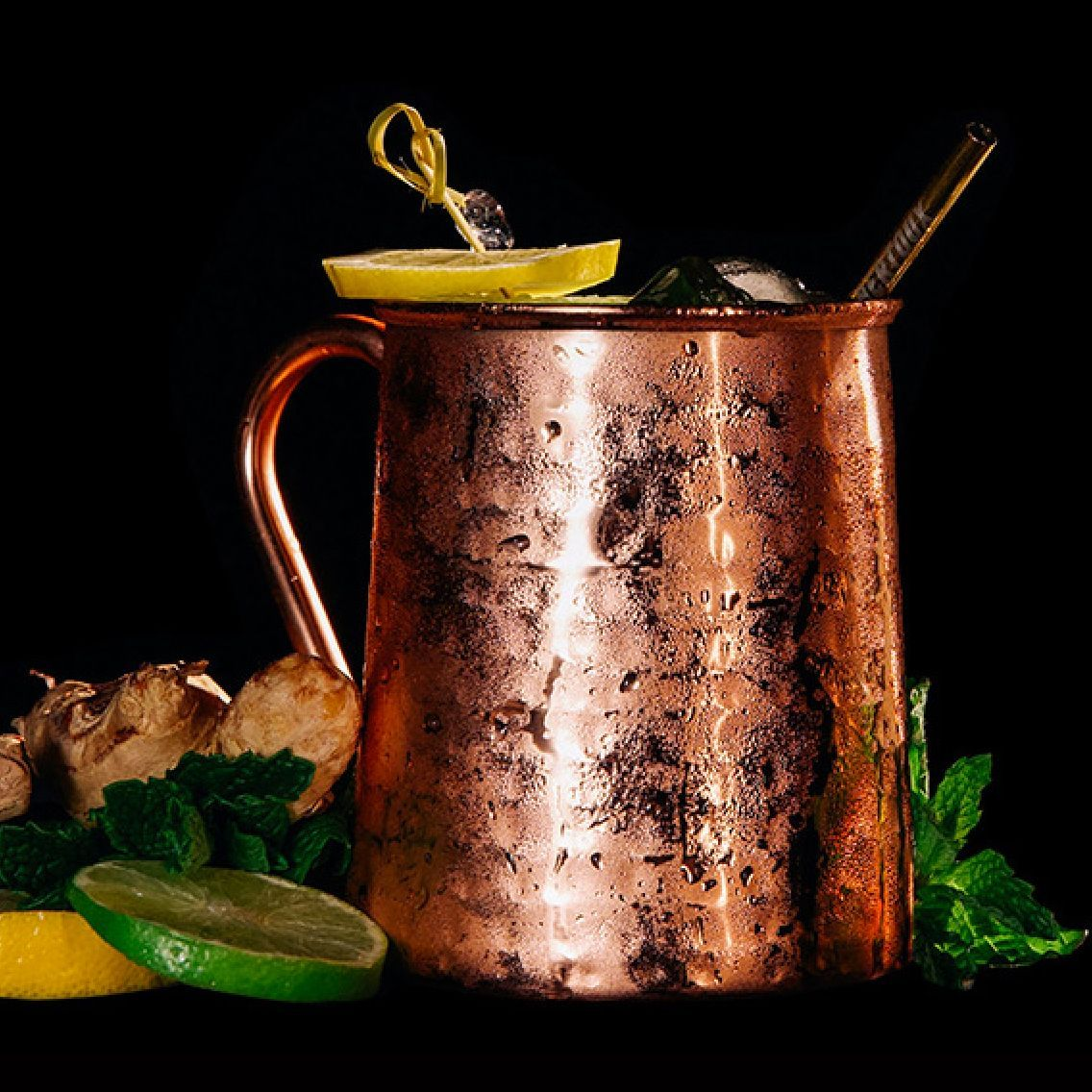 A creative gin version of a mule with Angostura Bitters to make it interesting.