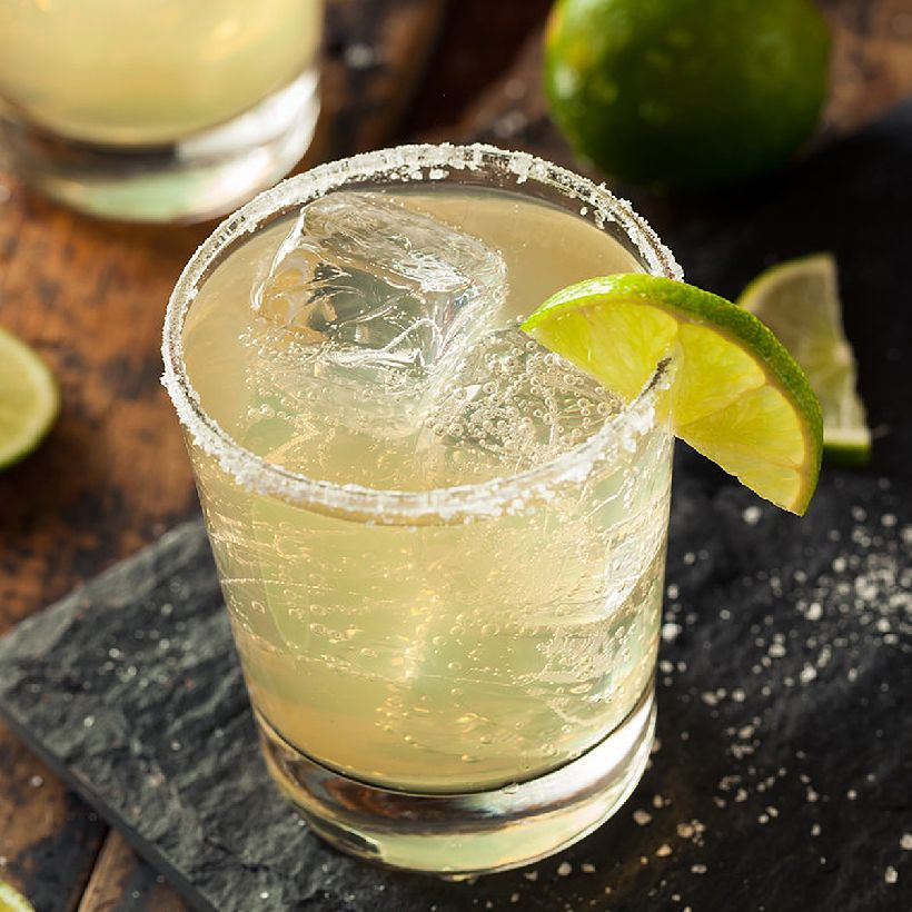 The Margarita is a tequila-based sour with a (usually orange) liqueur added to it. Served on the rocks or frozen, with or without salt, with additional fruit flavors or plain, it's a drink that has its origins in tropical climates and feels tropical on the tongue. Like all sours, the key is balance. Follow our recipe for a perfectly balanced Margarita! But know that this drink invites infinite modifications, beginning with your choice of tequila.