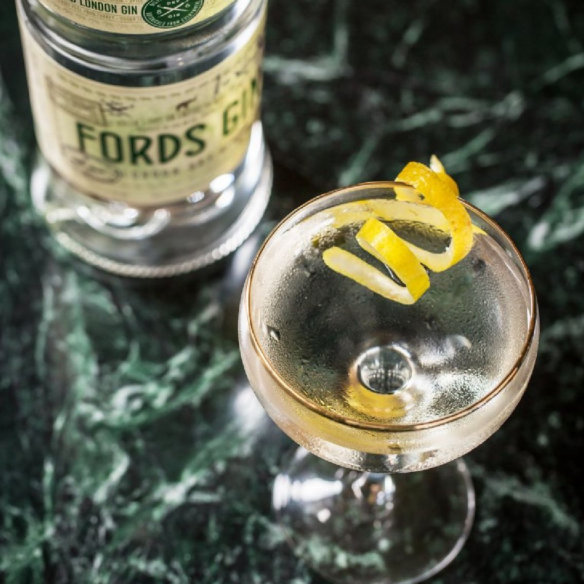 """Quite simply the king of cocktails, no drink has done more to push the cocktail into the limelight.  The image of a martini glass, punctuated with an olive, timelessly endures through film, art, and culture. A marriage of gin and vermouth, nobody is quite sure who first got them to say """"I do"""" in the late 1800s. Which gin? (we recommend Fords Gin) Which vermouth? How much gin, how much vermouth? Bitters? Which garnish? What glass? The most personal of cocktails. Everybody has (or should have) an opinion on how to make the perfect martini."""