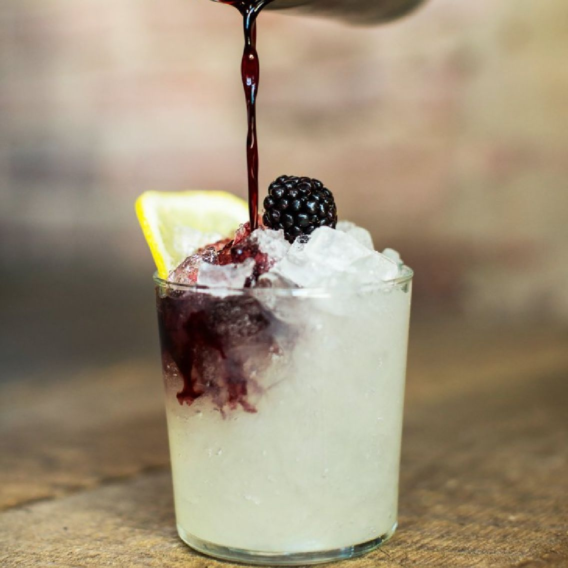 """The drink that saved gin and cocktails.  Legendary London bartender Dick Bradsell created the Bramble whilst working at Fred's Bar in London's Soho in the 1980s. A well-balanced combination of dry gin, lemon, and crème de mûre, the Bramble was intended to be a quintessentially British cocktail inspired by British avours. It rapidly became the go-to gin drink in many bartenders' repertoire and arguably propelled gin cocktails back into the limelight.  Perhaps the only true""""modern classic""""cocktail, Dick realised it had nally ascended to the highest of cocktail heights when famously a French bartender argued with him across the bar and refused to believe that he had invented the drink.  """"You always have to try and achieve perfection in bartending, it doesn't just happen; you have to make the effort."""" – Dick Bradsell, 2003."""