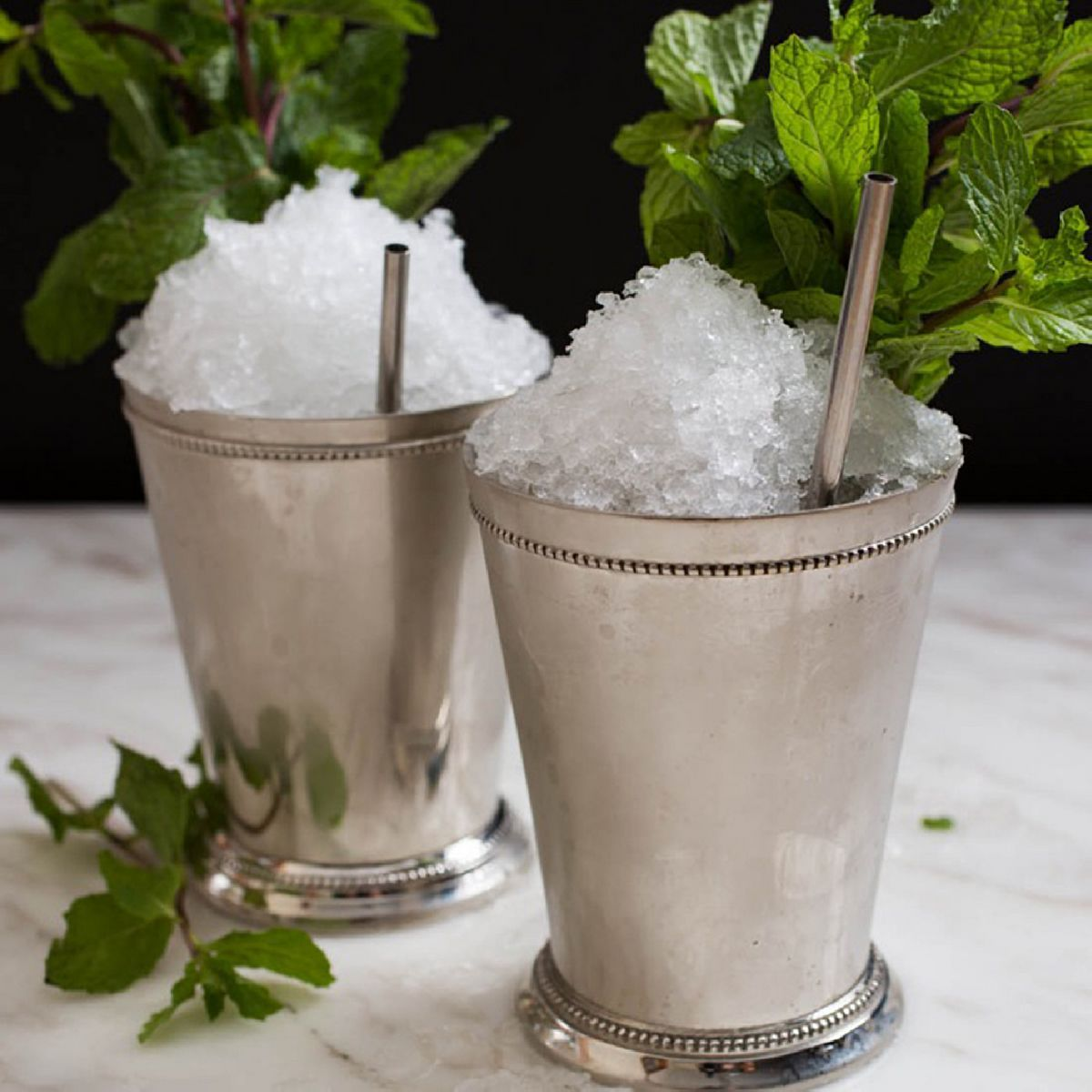 The signature drink of the Kentucky Derby and possibly the whole of the South. This is a bourbon-based cocktail that prominently features a cooling and fragrant use of fresh mint and crushed or shaved ice. Even the description sounds refreshing!  The julep is actually a whole category of cocktails served over crushed ice. We might even be willing to debate whether a Mai Tai is technically a julep. As long as we make a few to sample...  Photo: The CocktailDB