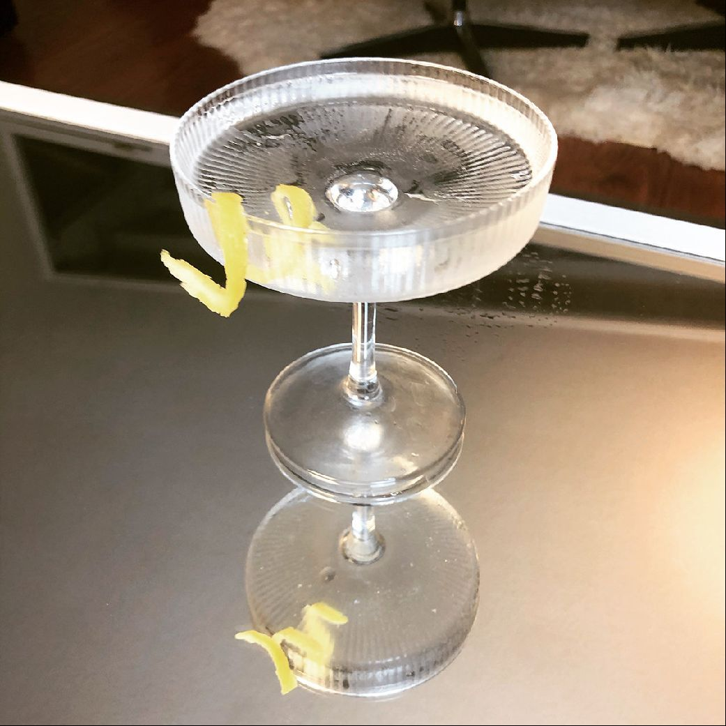 Who doesn't love a Star Wars-themed cocktail! I didn't use a question mark, because that was obviously a rhetorical question, and the answer is NO ONE. So here's another recipe created with the far, far away galaxy in mind. The wettest martini under the Twin Suns. Slightly wetter than a 50/50 and with minimal sand.