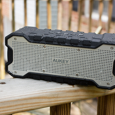 Wirelessly stream your music to this rugged Aukey Bluetooth Speaker on sale for $21