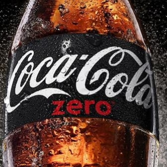Coca Cola Zero bottle with dark background and a splash of mist.