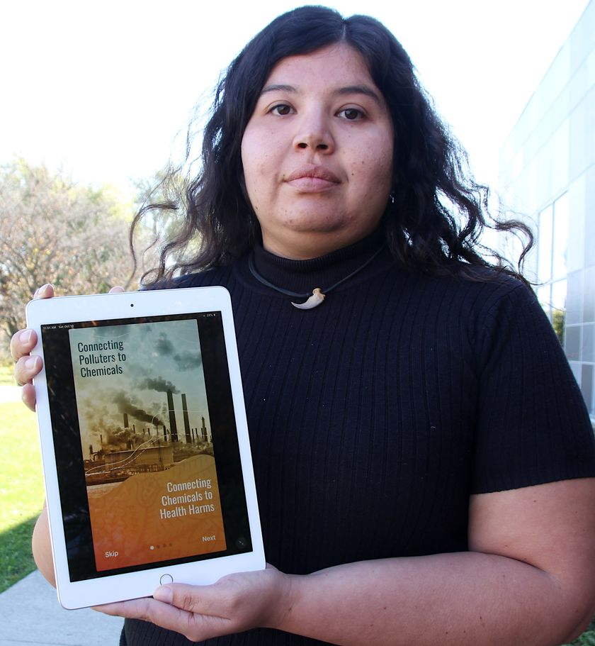 Vanessa Gray holding Pollution Reporter App at launch, from Sarnia Observer