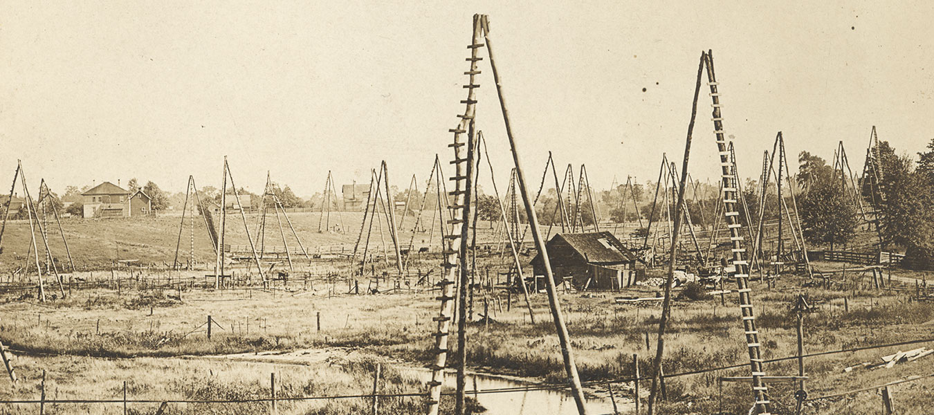 Photo of Oil Springs and three pole wells, 1858. Oil Museum, Lambton County Library.