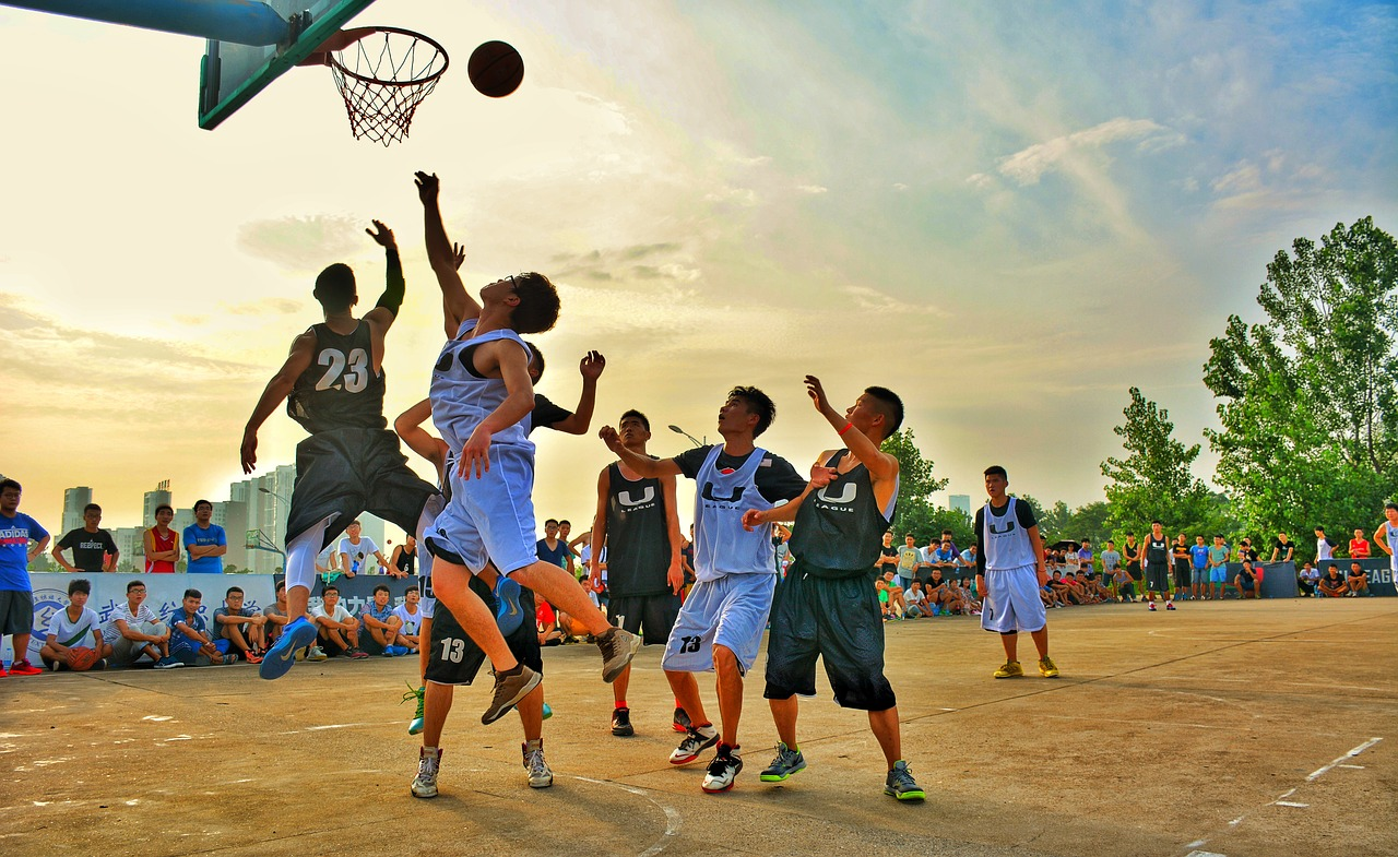 An even number of players playing basketball.