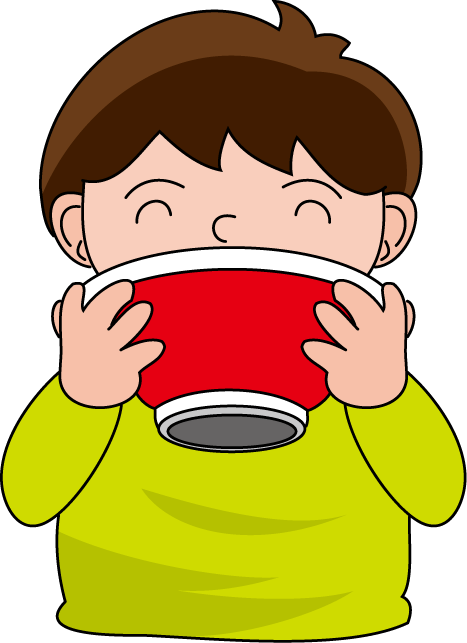 A boy eating a bowl of soup.