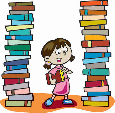 A girl standing in between large stacks of books.