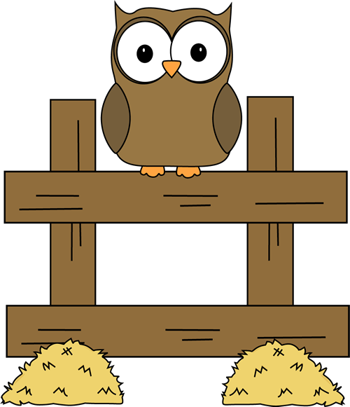 An owl is sitting on a fence.