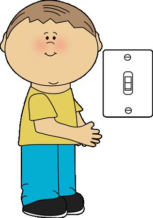 A boy standing next to a light switch.
