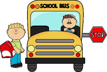 A boy getting onto a school bus.